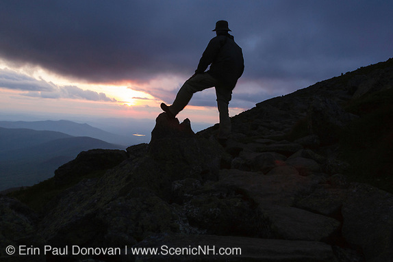 Silhouette of rock cairn and hiker along the Appalachian Trail near Mount Clay in the White Mountains, New Hampshire USA during the summer months. (Erin Paul Donovan | ScenicNH.com Photography)