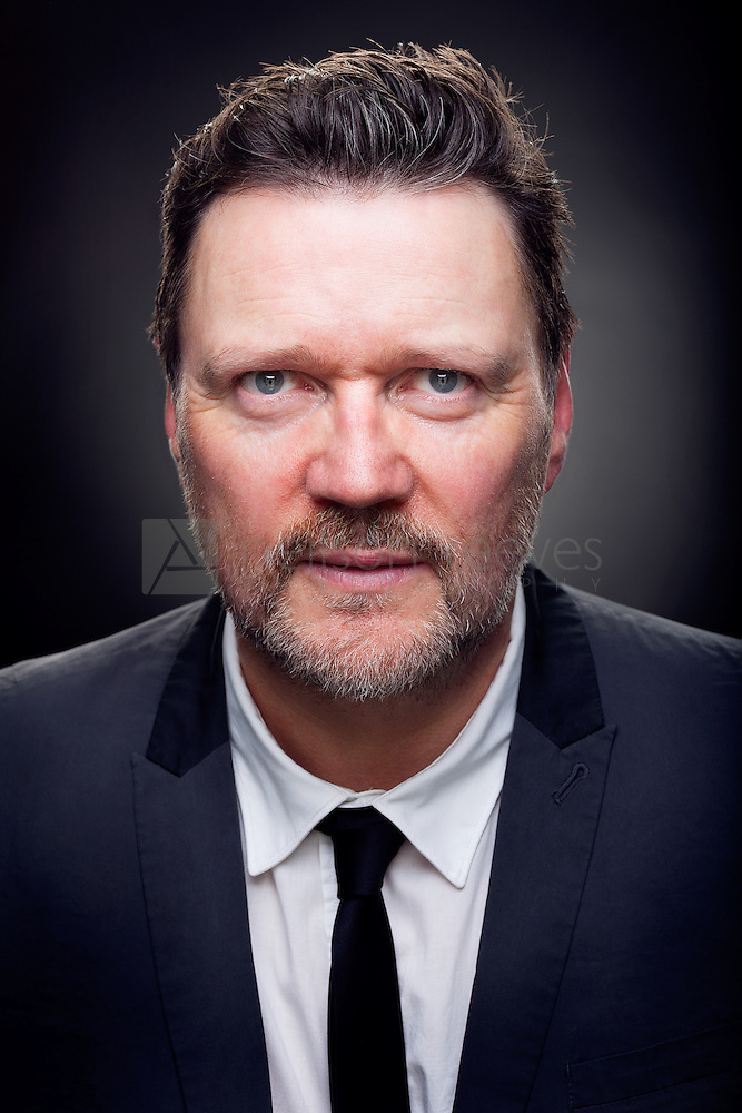 Ian Puleston-Davies Theatrical actor headshot in colour. Ian is wearing rock and roll teddy boy type suit with white shirt and thin black tie (Colin Boulter)