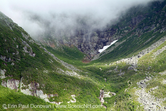 Clouds engulf Tuckerman Ravine from Boott Spur Trail during the summer months in the scenic landscape of the White Mountains, New Hampshire USA ..Notes: Boott Spur Trail is located on the eastern slopes of Mount Washington.