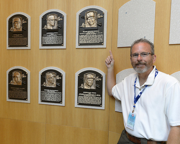 COOPERSTOWN, NY - JULY 28:  Photographer Ron Vesely poses next to the plaque of 2014 Hall of Fame inductee Frank Thomas, on display at the Baseball Hall of Fame and Museum in Cooperstown, New York on July 28 2014. (Ron Vesely)