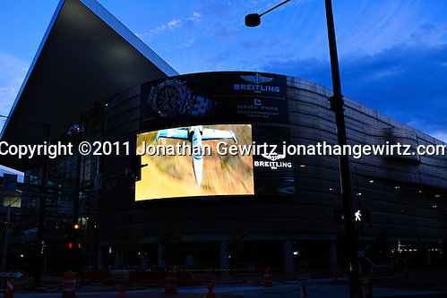 Video advertising billboard on the exterior of the Colorado Convention Center in downtown Denver at dusk. (Jonathan Gewirtz)