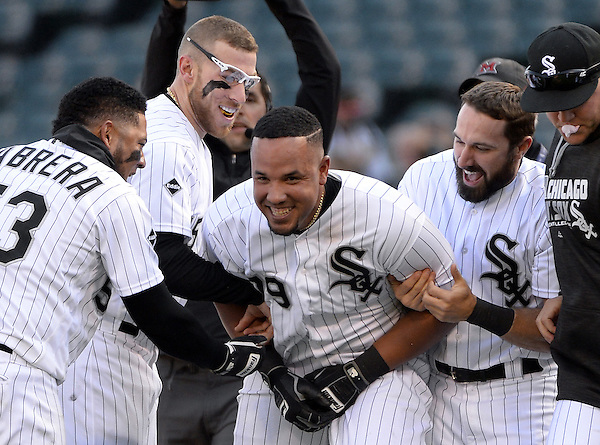 CHICAGO - APRIL 23: Jose Abreu #79 of the Chicago White Sox celebrates with teammates after hitting a walk-off RBI single in the eleventh inning against the Texas Rangers on April 23, 2016 at U.S. Cellular Field in Chicago, Illinois. The White Sox defeated the Rangers 4-3 in 11 innings. (Photo by Ron Vesely) Subject: Jose Abreu (Ron Vesely)