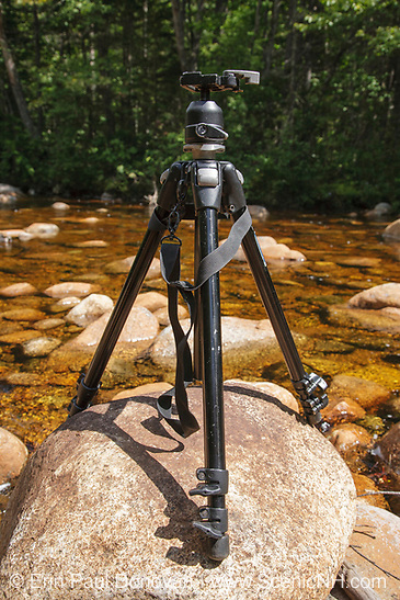How to get sharper images? A common question every photographer is asked. Pemigewasset Wilderness - Tripod on rocks along the North Fork East Branch Pemigewasset River in Lincoln, New Hampshire USA. The Pemi Wilderness is one of the best places to hike in the White Mountains of New Hampshire