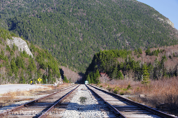 """Railroad tracks next to Crawford Train Depot (Conway Scenic Railroad) at the start of Crawford Notch State Park in the White Mountains, New Hampshire USA. The rock profile known as """"Elephant Head""""  can be seen on the left."""