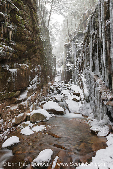 Franconia Notch State Park - Flume Gorge in Franconia Notch, New Hampshire USA during a snow storm. Blowing snow can be seen.