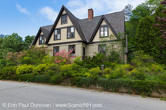 The Notchland Inn in Hart's Location, New Hampshire during the spring months. This granite mansion was designed and built by Dr. Samuel Bemis in the 1860s. Bemis quarried the granite for this mansion from a quarry he owned along the Sawyer River. It is also believed that Bemis was the first person to buy a commercially available camera in the United States.