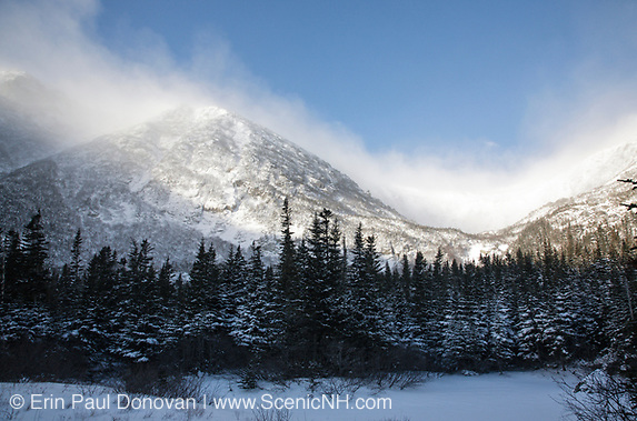 Mount Washington - Tuckerman Ravine in extreme weather conditions during winter months. Located in the White Mountains, New Hampshire USA. Strong winds cause snow to blow across the mountain tops.