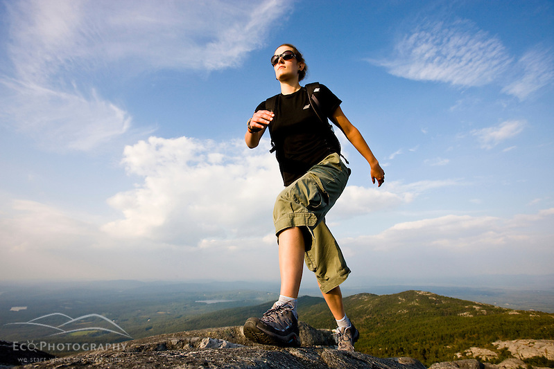 A woman hikes near the summit of Mount Monadnock in Monadnock State Park in Jaffrey, New Hampshire. (Jerry and Marcy Monkman)