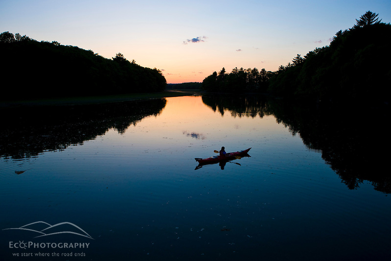 A woman kayaks on the upper reaches of the York River in York, Maine.  High tide.  Sunset. (Jerry and Marcy Monkman/EcoPhoto)