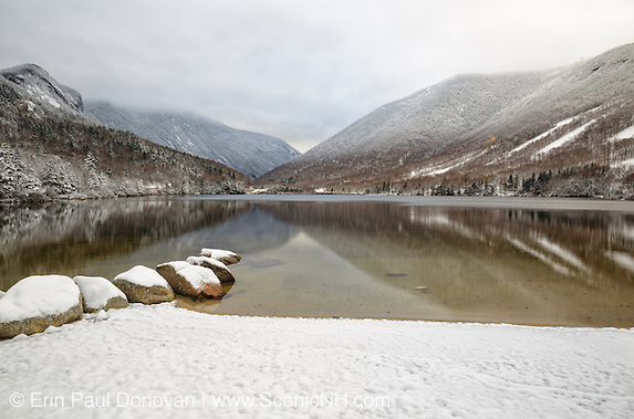 Franconia Notch State Park in Franconia, New Hampshire from Echo Lake during the autumn months after a dusting of snow.