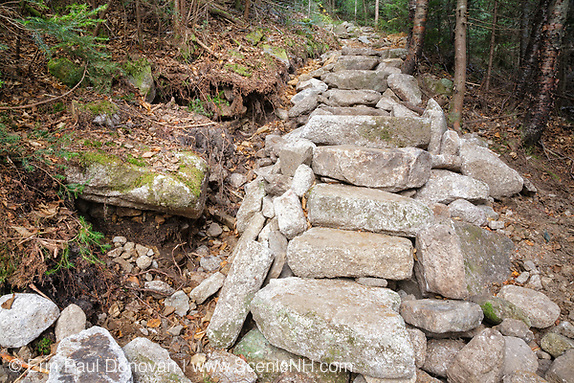 October 2011 - Newly installed stonework along the Mt Tecumseh Trail in the White Mountains, New Hampshire USA. After an inspection by FS in June 2012, it has been suggested this issue (large holes on left) will need to be corrected by a professional trail crew. In less than one year the hillside is collapsing and the stonework is not holding up. See here: http://bit.ly/1qY9GZY.