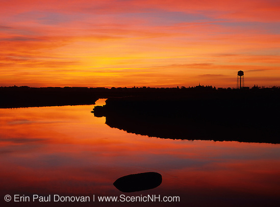 A salt marsh in Hampton, New Hampshire USA at sunrise, which is part of scenic New England.