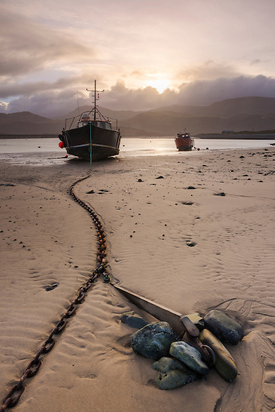 The Viking Boat stranded in Barmouth Harbour in North Wales