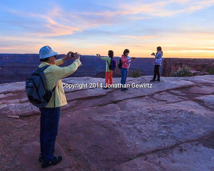 Chinese visitors to Dead Horse Point State Park, Utah. WATERMARKS WILL NOT APPEAR ON PRINTS OR LICENSED IMAGES. (Jonathan Gewirtz   jonathan@gewirtz.net)