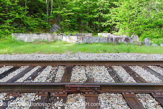 Site of the Willey House Station along the old Maine Central Railroad (near Ethan Pond Trail) during the spring months in Crawford Notch, New Hampshire. The railroad burned down this section house sometime in the 1980s.
