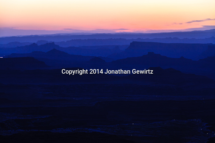 The brightening morning sky silhouettes distant ridges beyond Buck Canyon and the White Rim mesa in Canyonlands National Park, Utah. (Jonathan Gewirtz   jonathan@gewirtz.net)