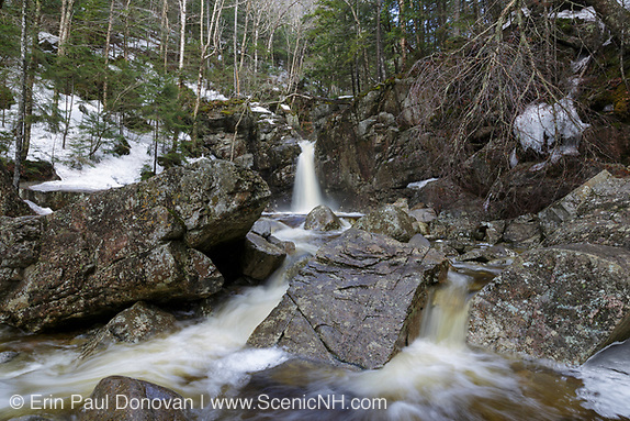 Kinsman Falls on Cascade Brook in Lincoln, New Hampshire during the spring months. These falls are located along the Basin-Cascades Trail, and are also known as Basin Falls and Tunnel Falls.