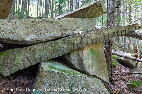 Remnants of granite splitting (plug and feathers) at the abandoned Bemis Granite Quarry along the Sawyer River in Harts Location, New Hampshire USA. Dr. Samuel Bemis quarried granite from this site, which he owned at the time, during the 1860s to build Notchland, a granite mansion in Hart's Location.