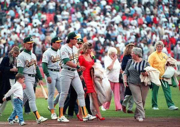 SAN FRANCISCO, CA-OCTOBER 1989: Jose Canseco ot the Oakland Athletics leaves the field with his family after a 6.9 magnitude earthquake cancelled Game 3 of the 1989 World Series between the San Francisco Giants and Oakland Athletics at Candlestick Park in San Francisco, California.  (Photo by Ron Vesely) (Ron Vesely)
