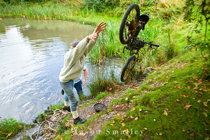 removing a bicycle from a pond (Jason Smalley)