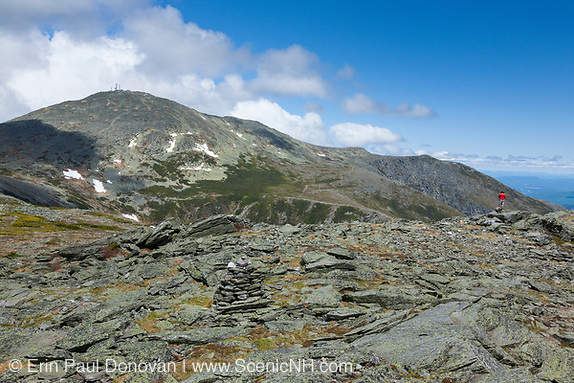 A hiker enjoys the view of Mount Washington from the summit of Boott Spur Mountain during the summer months. Located in the White Mountains, New Hampshire