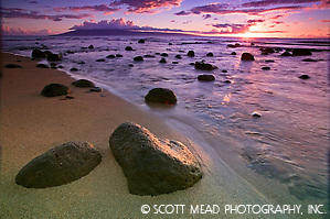 Rocks and ocean along the beach at sunset in Kahana, Maui, Hawaii (Scott Mead)
