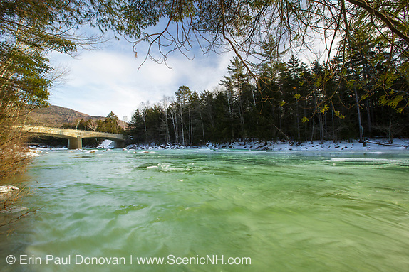 Kancamagus Scenic Byway - Green ice along the East Branch of the Pemigewasset River in Lincoln, New Hampshire USA during the winter months The Route 112 bridge is in view (Erin Paul Donovan | ScenicNH.com Photography)