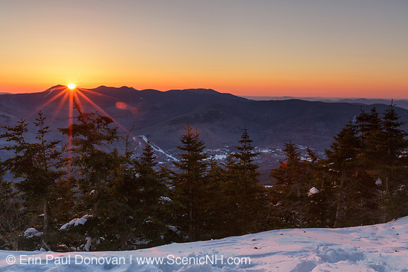 Sunrise from the summit of Mount Tecumseh in Waterville Valley, New Hampshire USA during the spring months. View shedding (unauthorized cutting) has improved the summit view. Forest Service has verified the cutting is unauthorized.