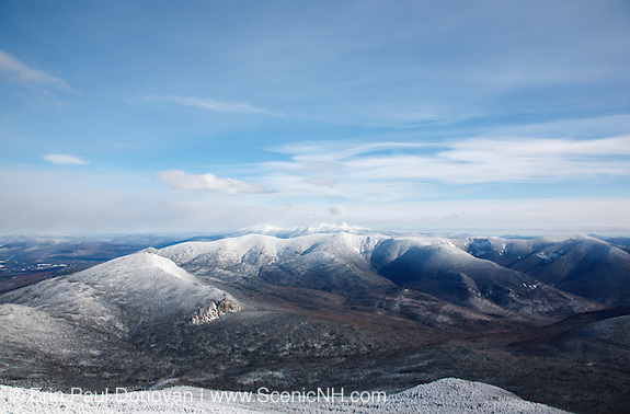 Pemigewasset Wilderness from Mount Lafayette during the winter months in the White Mountains, New Hampshire USA. Mount Garfield in above the cliffs and the northern end of Owls Head Mountain is on the right out of view. The foreground was logged during the East Branch & Lincoln Railroad era, which as was a logging railroad in operation from 1893 - 1948.