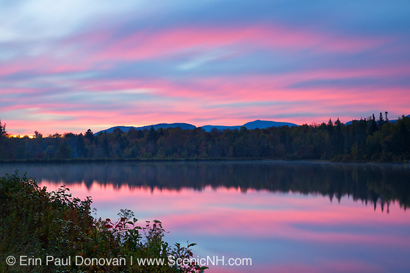 October at Durand Lake in Randolph, New Hampshire USA at sunrise during the autumn months.