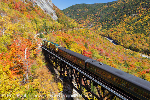 "Conway Scenic Railroad's ""Notch Train"" crossing the Willey Brook Trestle along the old Maine Central Railroad in Hart's Location, New Hampshire during the autumn months. This trestle is within Crawford Notch State Park. And since 1995 the Conway Scenic Railroad, which provides passenger excursion trains has been using the track."