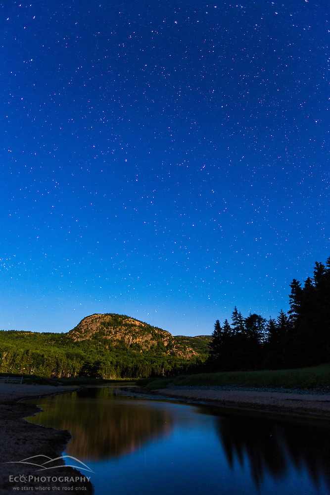 The Big Dipper over The Beehive bathed in moonlight. Maine's Acadia National Park. (Jerry and Marcy Monkman)