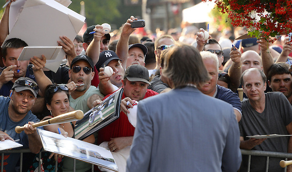 COOPERSTOWN, NY - JULY 26:  Fans call out for autographs as Hall of Famer Dennis Eckersley abliges  during the annual Parade of Legends down Main Street in Cooperstown, New York on July 26, 2014. (Ron Vesely)