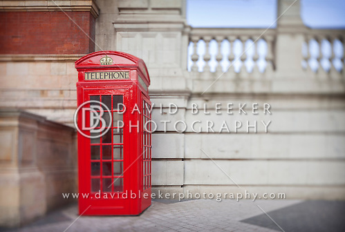 One of the iconic red telephone booths. This image was taken in Exhibition road near Hyde Park.  These phone boxes are known all over the world and were designed by Sir Giles Gilbert Scott. The blur is the effect of extreme tilt on a Canon TSE 24mm lens at F 3.5. (Photographer:© David Bleeker 2012)