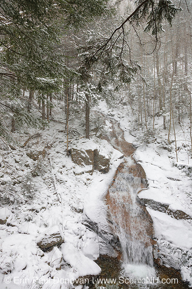 Franconia Notch State Park - Cascade Brook during a snow storm in Lincoln, New Hampshire USA. This waterfall is located in the Flume Gorge along Cascade Brook.