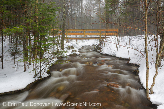 Foot bridge along the Mt Pemigewasset Trail in the White Mountains of New Hampshire during the winter month of February.