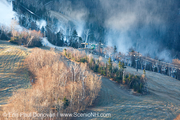 Franconia Notch State Park - Snow making at Cannon Mountain during the late autumn months in the White Mountains, New Hampshire USA from Artists Bluff. Cannon Mountain is the focal point of Franconia Notch State Park.