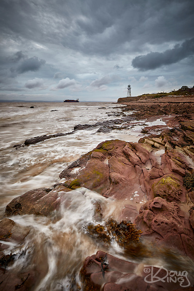 Black Nore Point, Portishead, at high tide with the old lighthouse in the background. (Doug King)