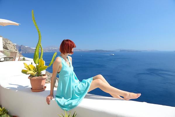 Woman on steps in town of Oia,Santorini, Kyclades,South Eagean, Greece,Europe Model release 0343 (Christian Heeb)