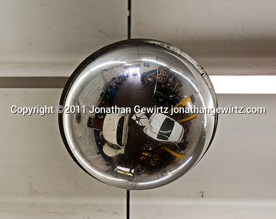 The interior of an automotive repair shop as reflected from a chromed planter on the ceiling. (Copyright 2011 Jonathan Gewirtz jonathan@gewirtz.net)