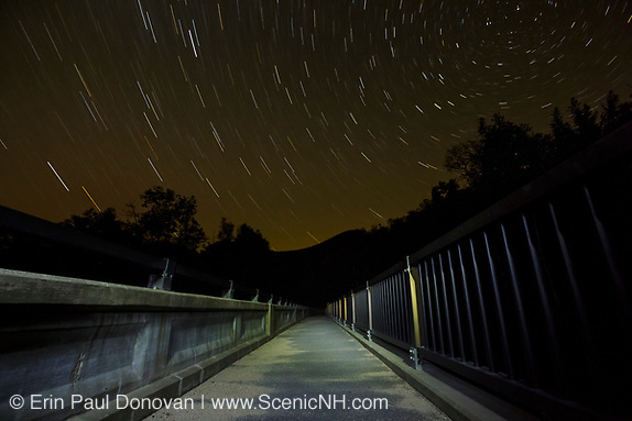 Night photography, star trails along the Kancamagus Scenic Byway (Route 112) in Lincoln, New Hampshire USA during the summer months.