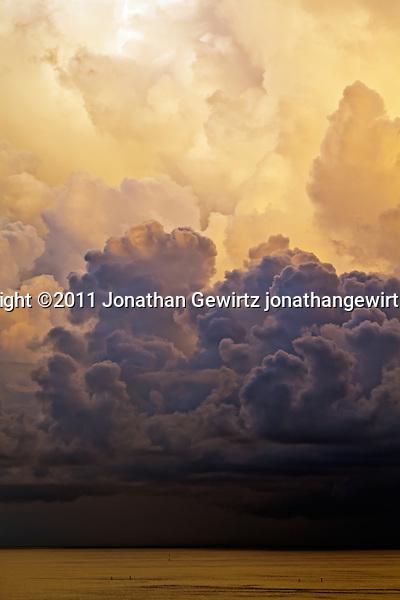 Towering thunderstorm clouds over the ocean. (Copyright 2011 Jonathan Gewirtz jonathan@gewirtz.net, Jonathan Gewirtz jonathan@gewirtz.net)