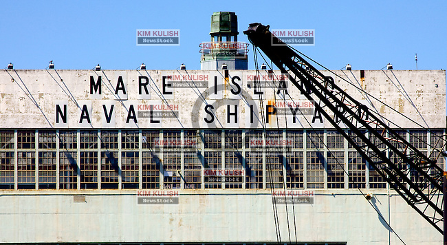 View of the Mare Island Naval Shipyard sign and crane along the waterfront in Vallejo, California. (Kim Kulish)