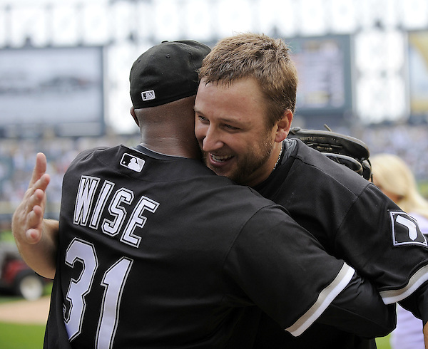 CHICAGO - JULY 23:  Mark Buehrle #56 of the Chicago White Sox hugs outfielder DeWayne Wise #31 who made a great catch in the ninth inning enabling Buehrle to record the 18th perfect game in major league history against the Tampa Bay Rays on June 23, 2009 at U.S. Cellular Field in Chicago, Illinois.  The White Sox defeated the Rays 5-0.  (Photo by Ron Vesely) (Ron Vesely)