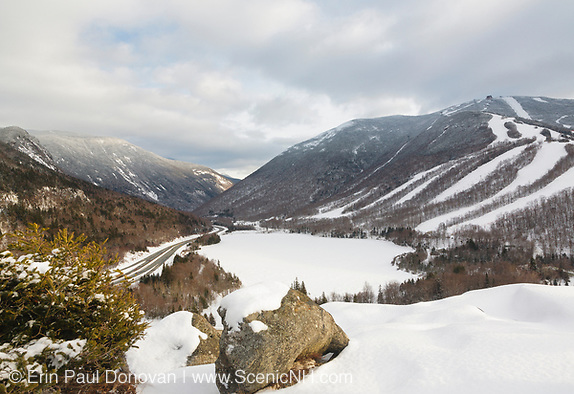 Franconia Notch State Park from Artists Bluff during the winter months in the White Mountains, New Hampshire USA. Echo Lake (center) is frozen over and Cannon Mountain is on the right.