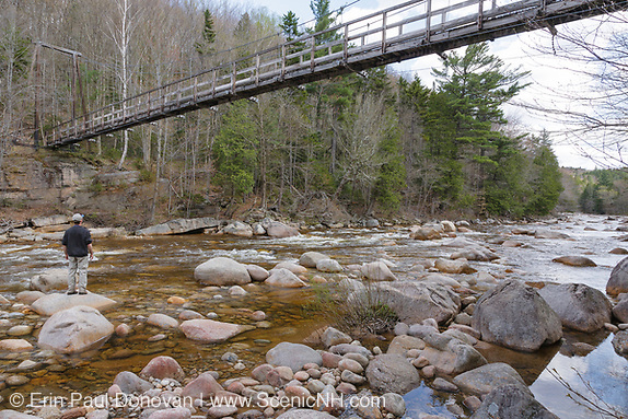 Pemigewasset Wilderness -180 foot Suspension bridge, which spans the East Branch of the Pemigewasset River along the Wilderness Trail in Lincoln, New Hampshire USA. This footbridge is located at the Trestle 17 location along the East Branch & Lincoln Railroad, which was an logging railroad in operation from 1893-1948.