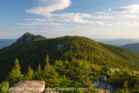 Mount Chocorua from Middle Sister Mountain in Albany, New Hampshire USA during the summer months. This mountain is not a roadside attraction and requires a photographer to hike a number of miles. With numerous trails leading to the summit,