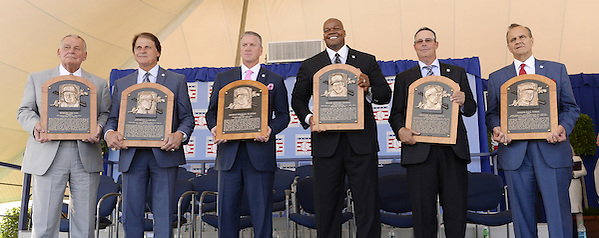 COOPERSTOWN, NY - JULY 27:  2014 Baseball Hall of Famer inductees (from left to right) Bobby Cox, Tony LaRussa, Tom Glavine, Frank Thomas, Greg Maddux and Joe Torre pose for a photo with their Hall of Fame Plaques following the 2014 HOF induction ceremonies held at the Clark Sports Center in Cooperstown, New York on July 27 2014. (Ron Vesely)
