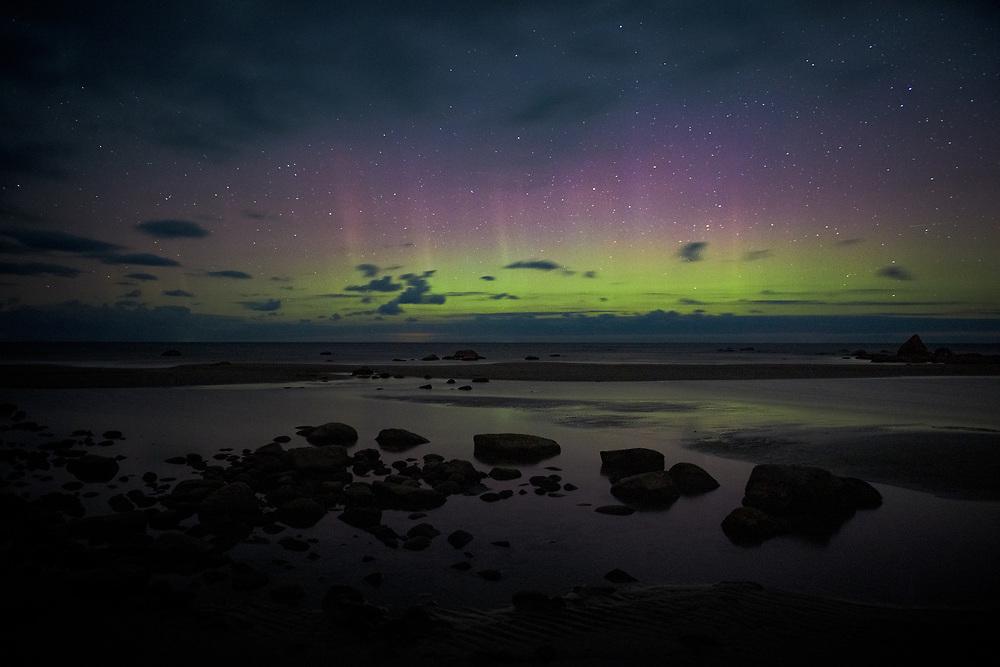 Night sky with Aurora borealis over rocky seashore, Mērsrags, Kurzeme Seacoast, Latvia, Ⓒ Davis Ulands | davisulands.com (Davis Ulands/Ⓒ Davis Ulands | davisulands.com)