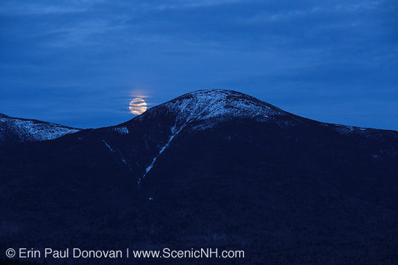 April Moonrise behind Mount Eisenhower in the  White Mountains of New Hampshire USA during the spring months. Mount Eisenhower is part of the Presidential Range.